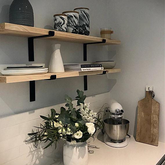 Shelf Bracket On Kitchen Wall With Flowers
