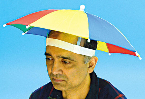 The umbrella hat, both practical and stylish.