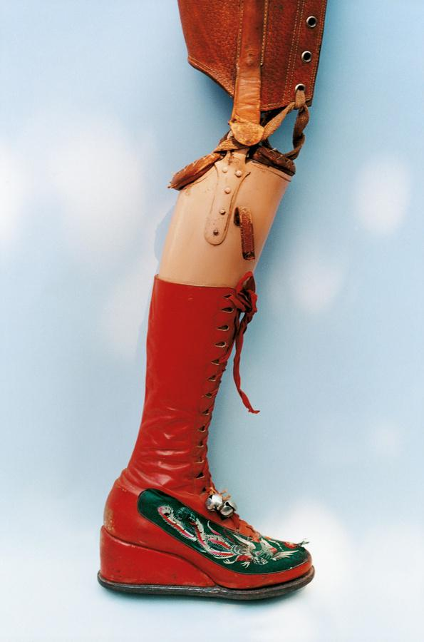"""Another piece from the Ishiuchi Miyakoexhibit at the Michael HoppenGallery .   The Guardian  , """"Kahlo's leg was amputated in 1953. She designed this prosthetic leg with embroidered red lace-up boots and a bell attached."""""""