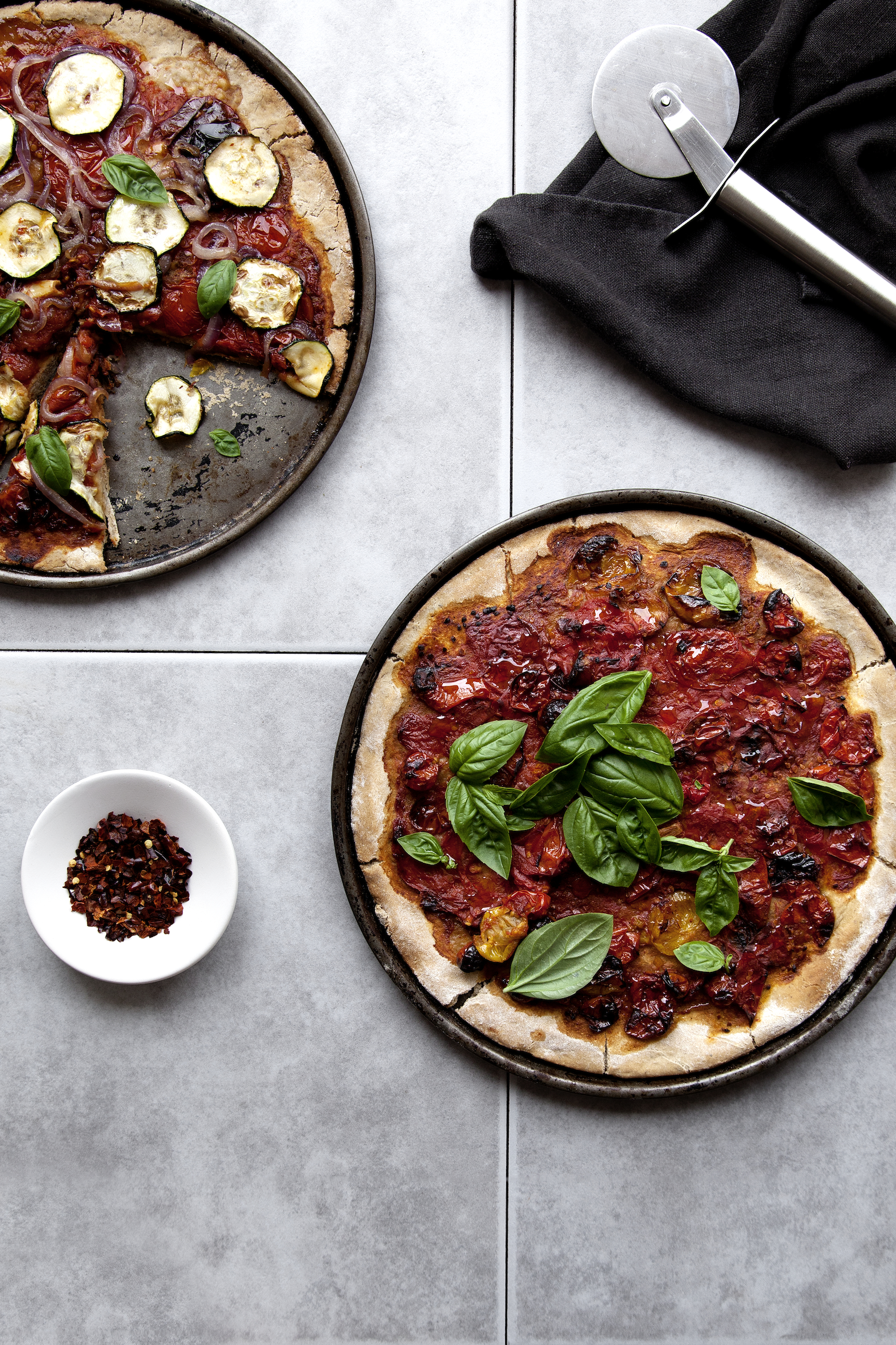 Homemade Pizzas// Kenkō Kitchen. Image taken from the Kenkō Kitchen Cookbook.  Australian edition  out now through Hardie Grant, out March/April through Hardie Grant UK and Rizzoli USA. Photography by Elisa Watson , styling by Kate Bradley (Kenkō Kitchen) and Sally Bradley.