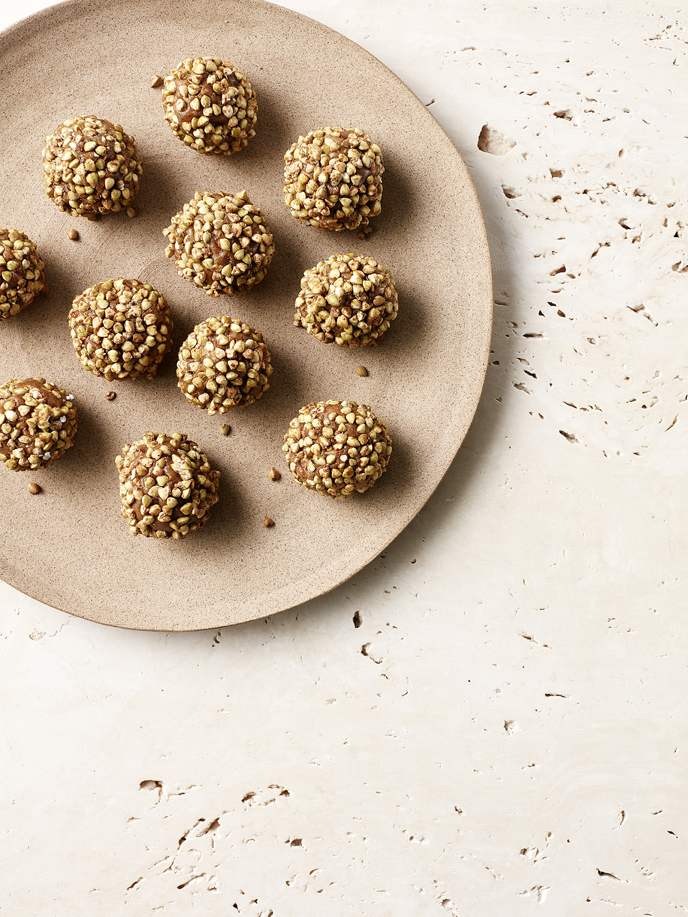 Golden Funtime Balls // Kenkō Kitchen. Image taken from the  Bliss Bites  Cookbook.Cookbook out December 1st through Hardie Grant. Photography by  Elisa Watson , styling by  Caroline Velik .