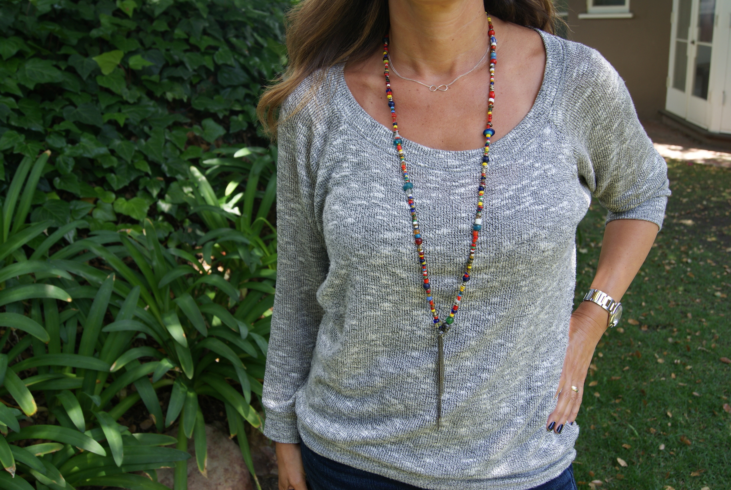 Long tribal necklace by  nathan&moe , $175. Sterling  silver infinity choker necklace  by Wanda Gale Jewelry Design.