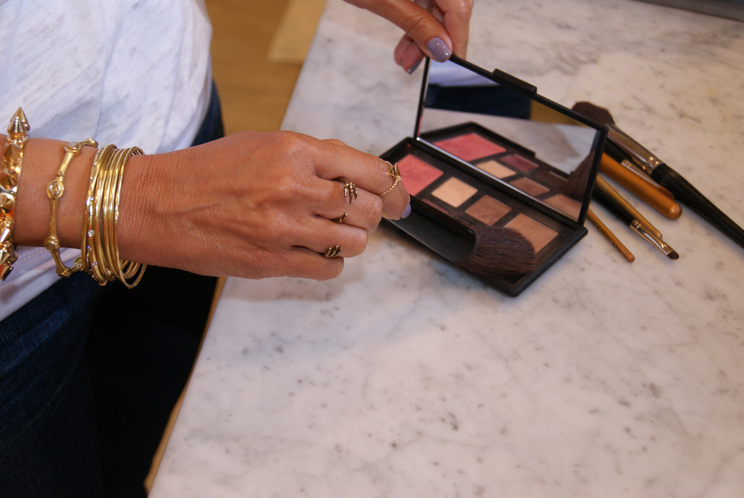 Step 1: Use a large blush brush and generously apply Laguna bronzer all over face.