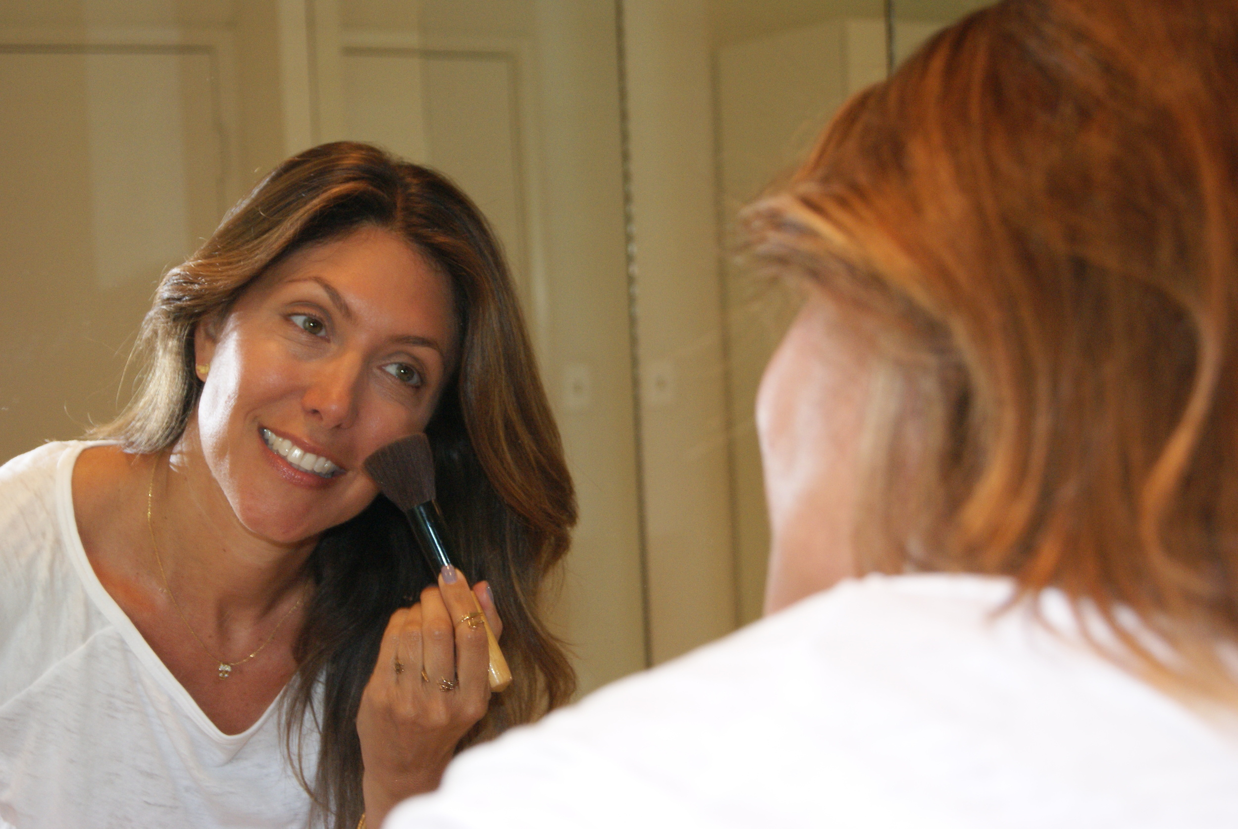 Apply bronzer all over face after using your favorite foundation and  concealing under eye circles and blemishes.
