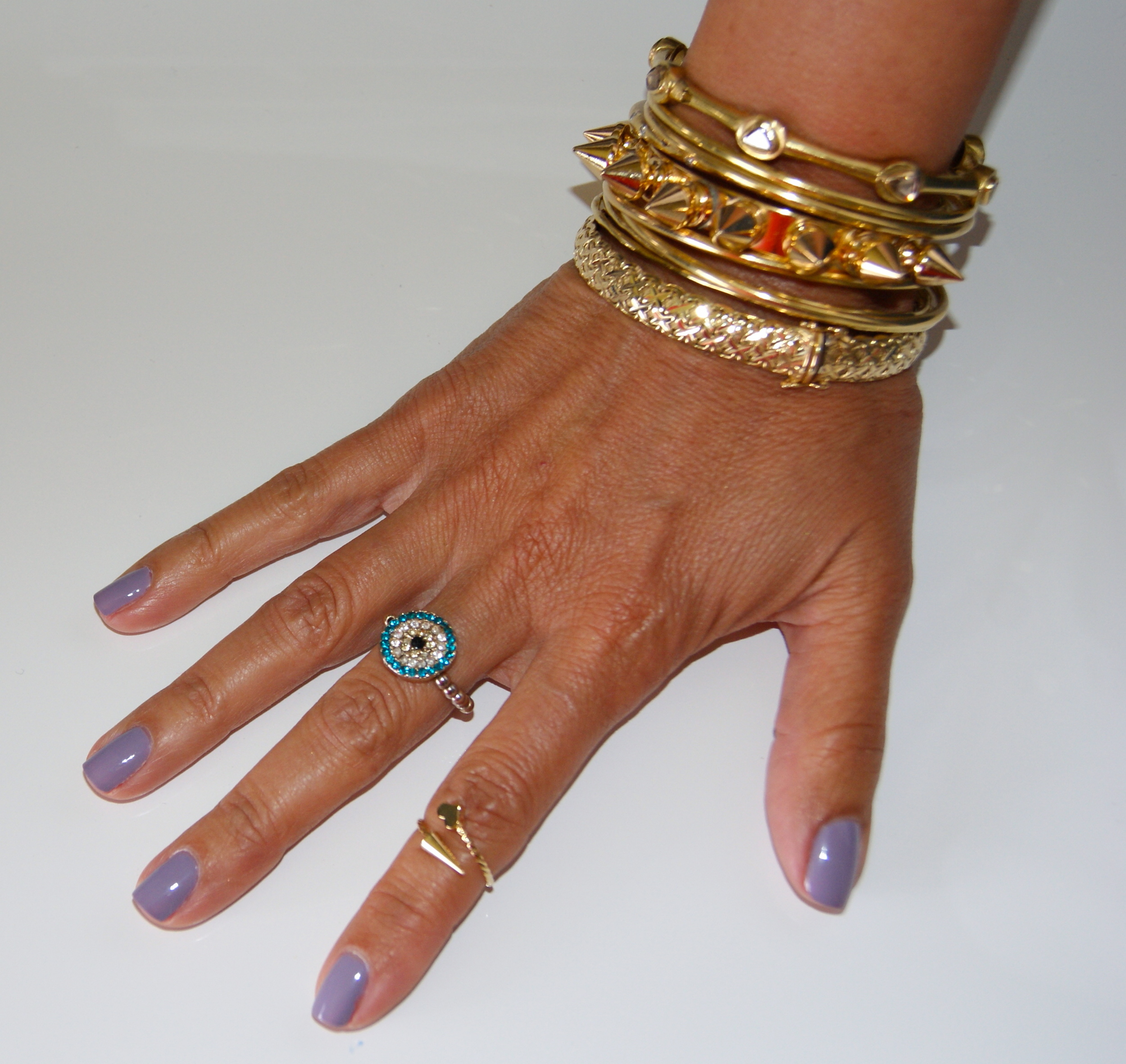 Spike bracelet by Courtney Lee Collection, $225  Other bracelets are fine jewelry by B. Coplan Collection, Etoile bangle by  Tiffany & Co. , and vintage. Rings: Flea market finds.  Nail polish: Bangle Jangle by Essie, 2.99