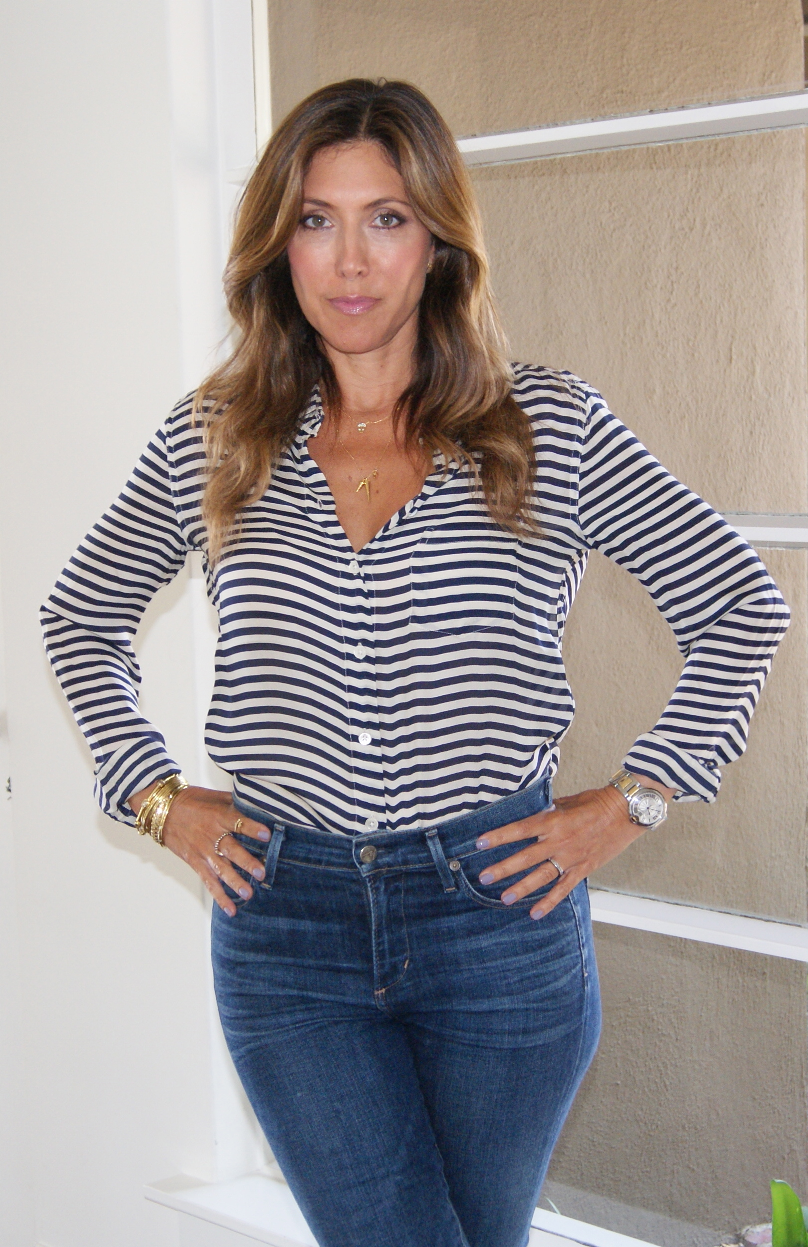 Striped blouse by  Closed . Tuck in blouse to show off your waistline!