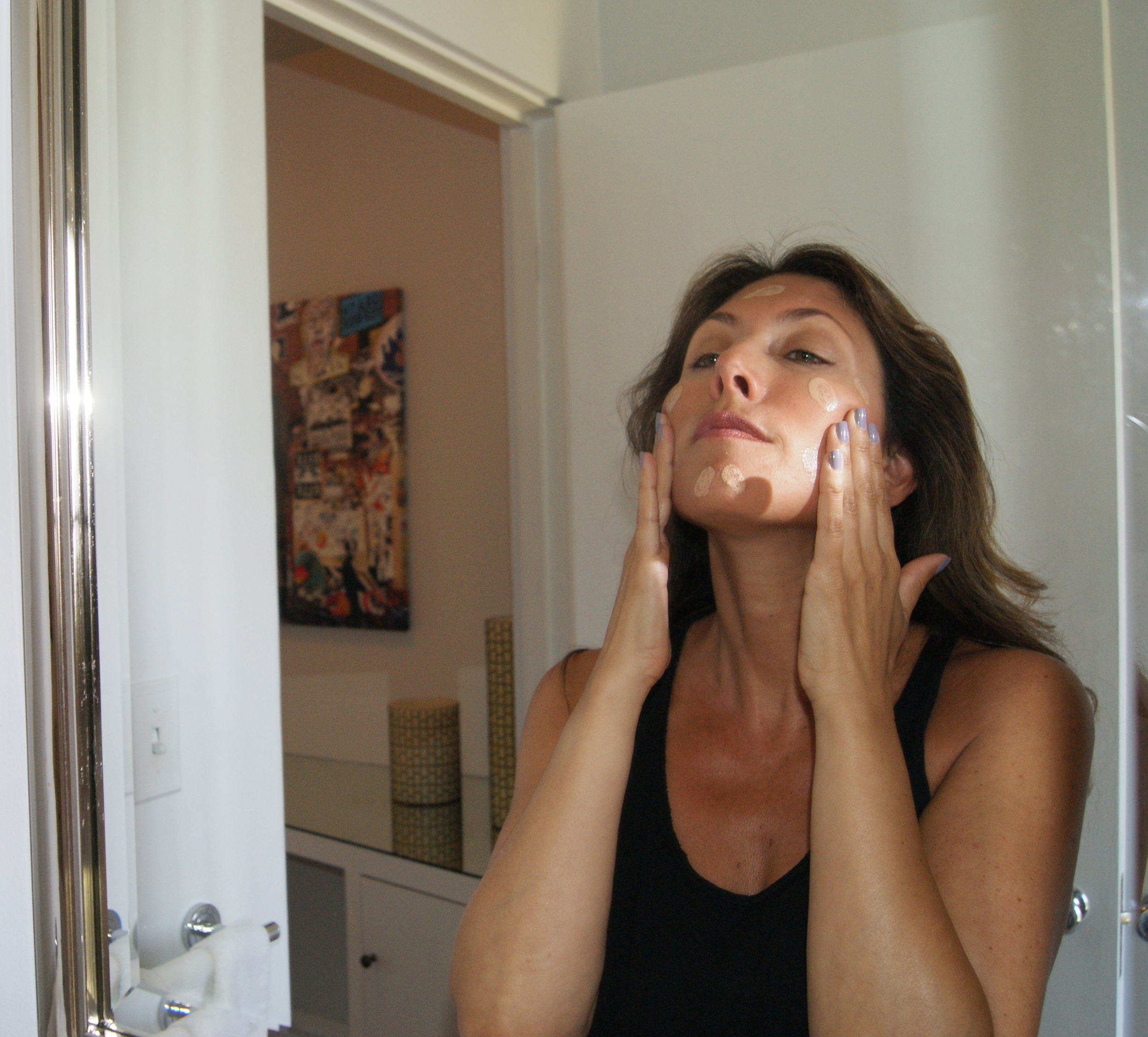 Apply tinted moisturizer with finger tips and blend.