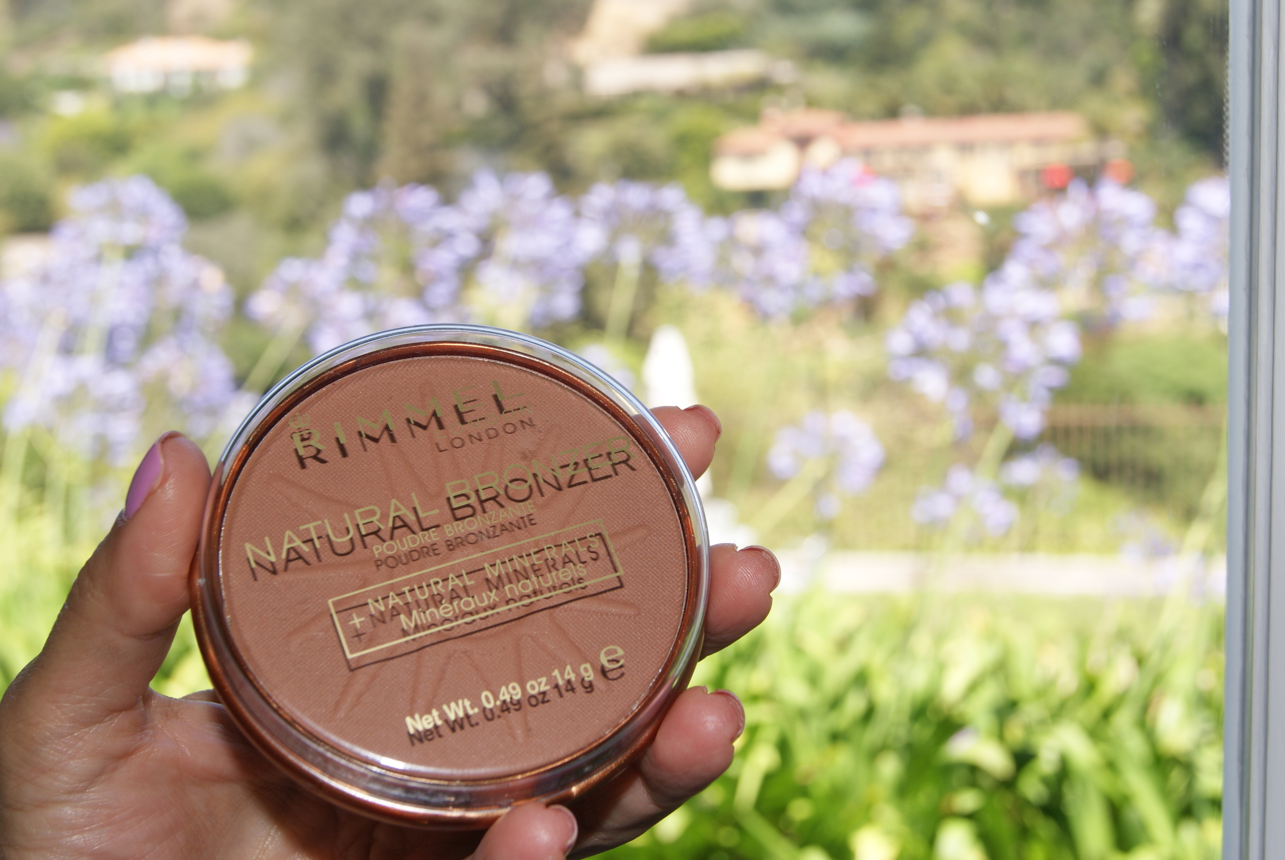 Rimmel London Natural Bronzer  gives you a natural sun-kissed glow! I like to dust it on my cheeks, nose forehead and chin for an overall bronzed look.