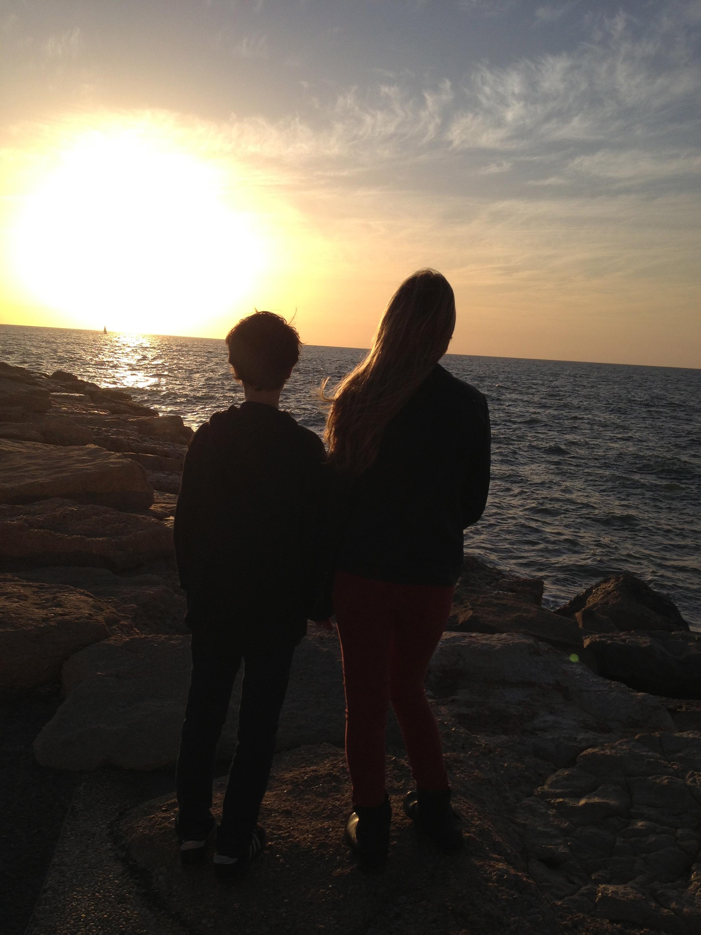 My children Alex and Rachel on the beach enjoying the sunset in Tel Aviv, Israel.