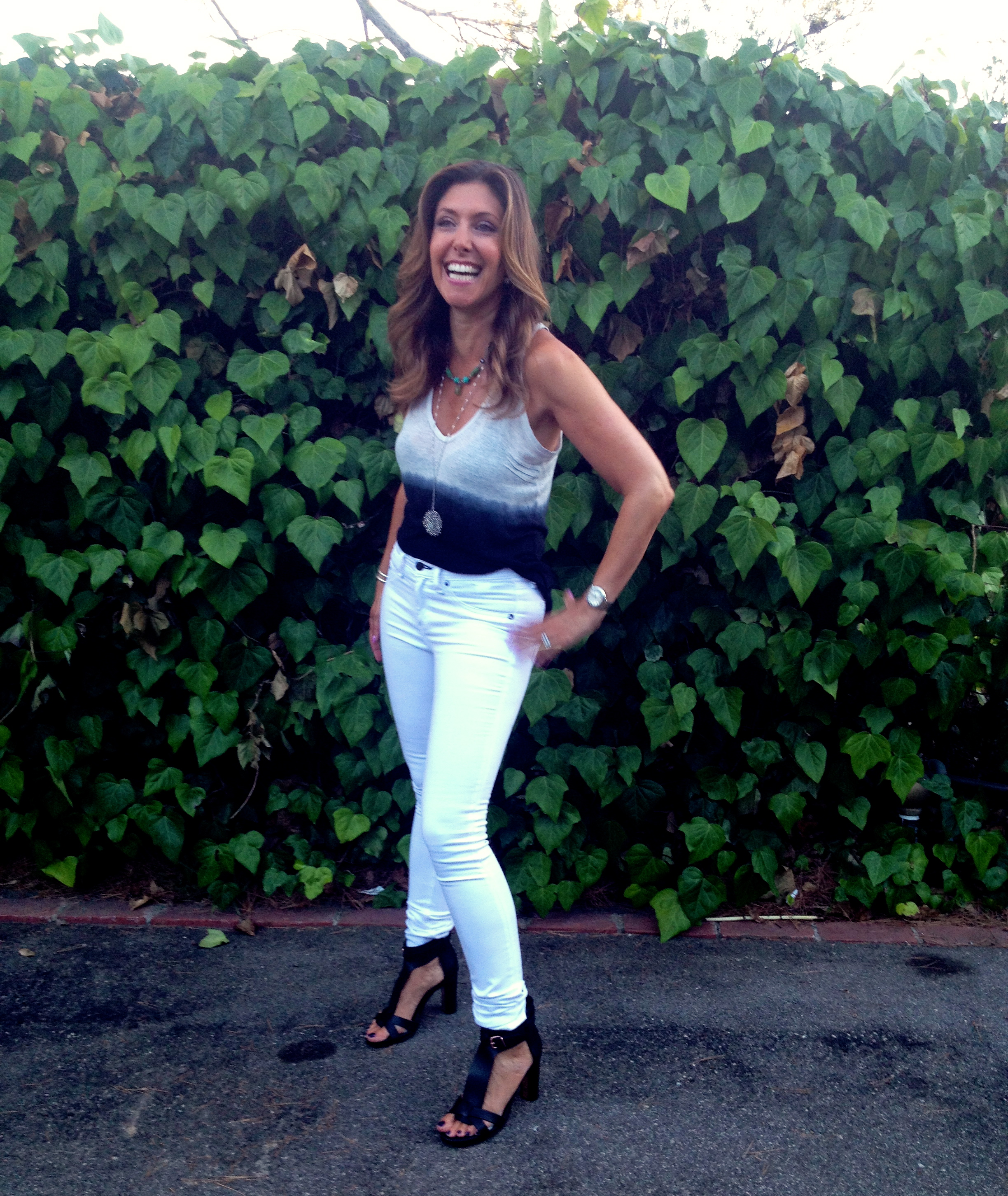 Top by  Zadig & Voltaire $101  . Pants: high-rise rag & bone white skinnies, $176.  Shoes:  Veronique Branquinho $190 .