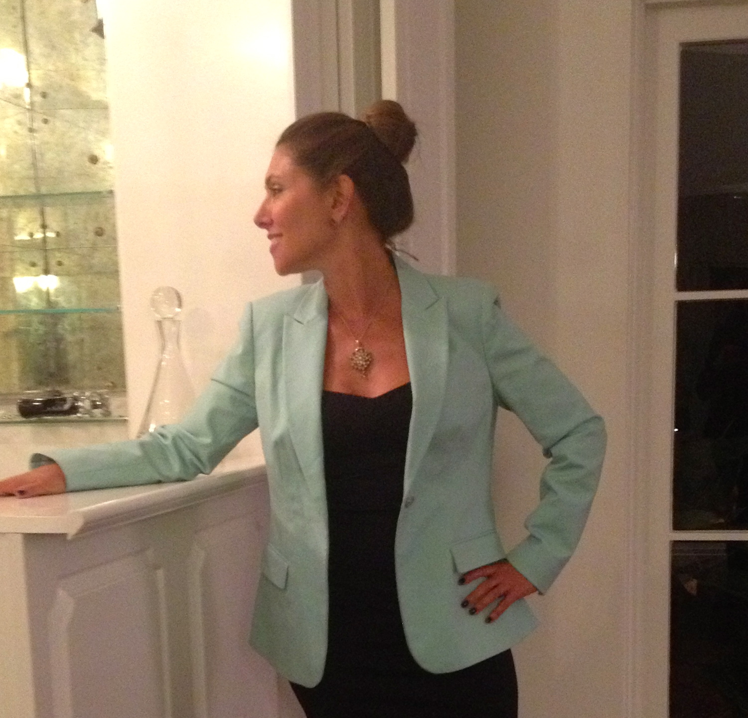 Sporting the top bun.  Mint green blazer by Vince Camuto. On sale now for $81.99.