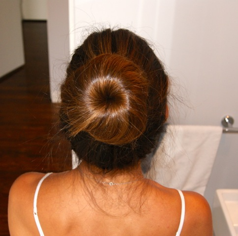 The perfect bun made easy! Use hairspray to secure fly-aways.