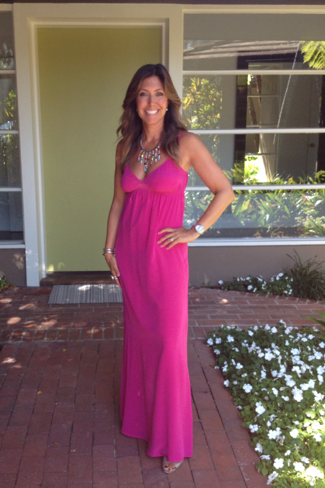 A long dress should be hemmed to fall about 1/4 inch from the floor creating one clean long line. Front of shoes should just peek out. Dress pictured here is by Twelfth Street by Cynthia Vincent  (no longer available).