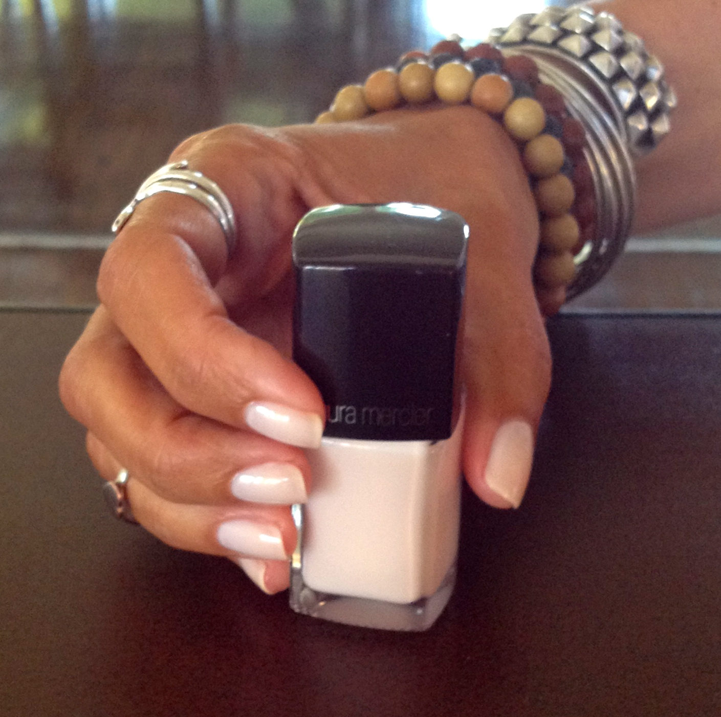 Laura Mercier, Limited Edition nail color,  Bare Angel, $18 . It's formaldehyde-free and very chip resistant!