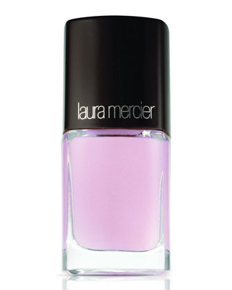Laura Mercier's Bare Angel nail lacquer  has a light pink tone in the bottle but reads like a neutral white with pink undertones. (It will appear a bit more pink if you are fair skinned).