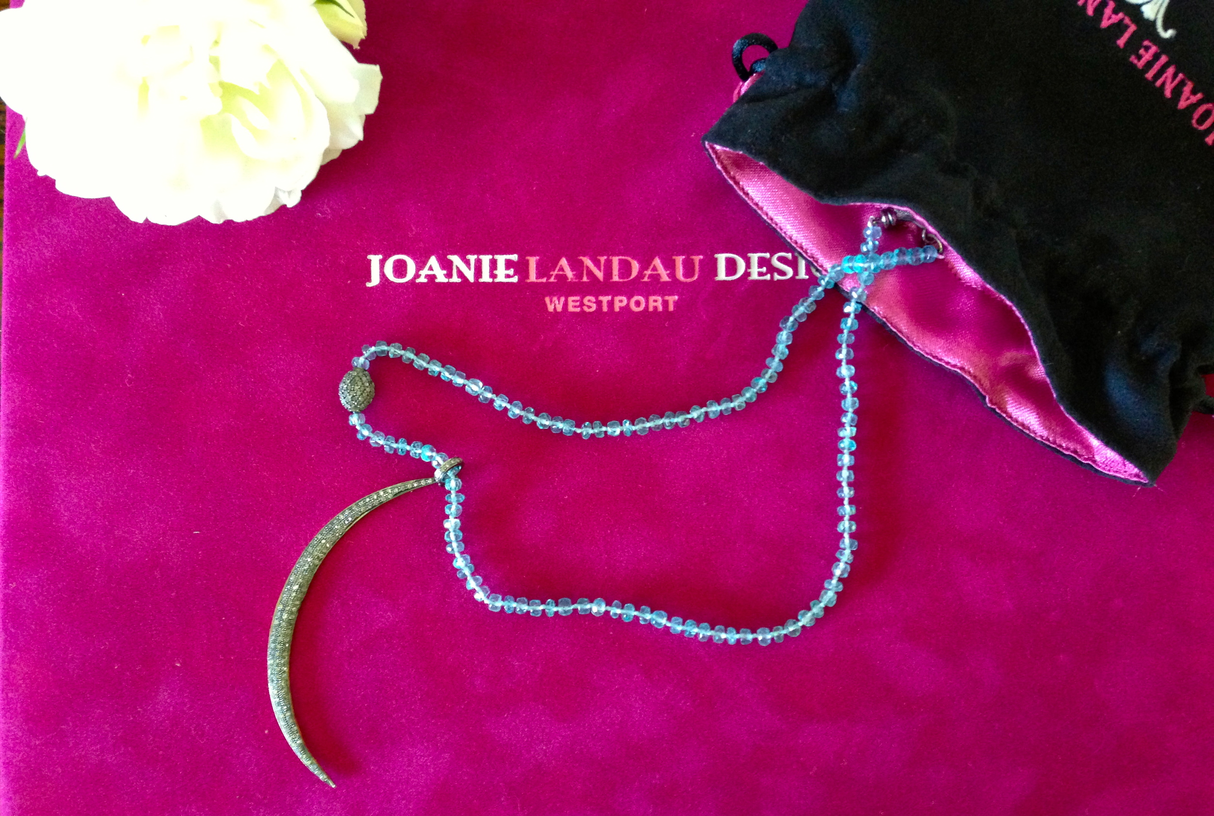 "Joanie Landau Designs, Waning Crescent Moon    Pave` Diamond Moon (3"" L) set in Blackened Silver, Backed in Gold Plate with Diamond Bail, on a strand of 3mm Faceted Apatite or Moonstone Rondelles, Off-Center Pave` Diamond Oval, Diamond Lobster Claw & End Tag. 16"" L with 2"" Extender Chain. $1428"