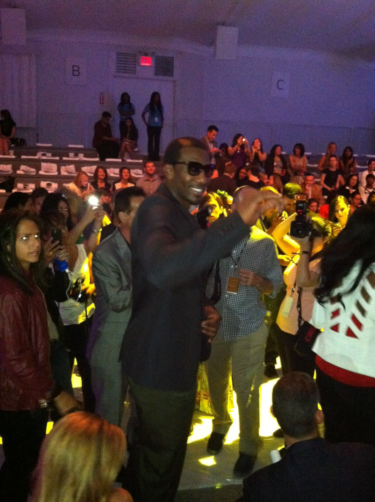 The fashionable Amar'e Stoudemire front row at the show to watch his wife strut for the Amar'e Stoudemire Foundation