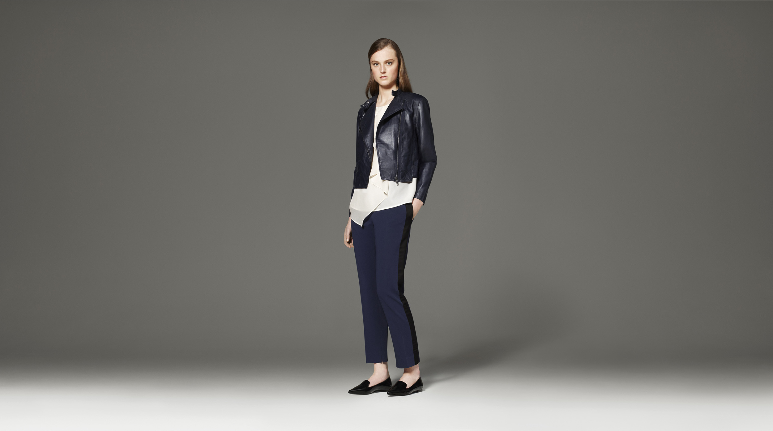 Perfect layers for fall!  Ruffle Tank in White, $26.99, paired with Tuxedo Pant, $39.99, and Leather Jacket in Navy, $249.99