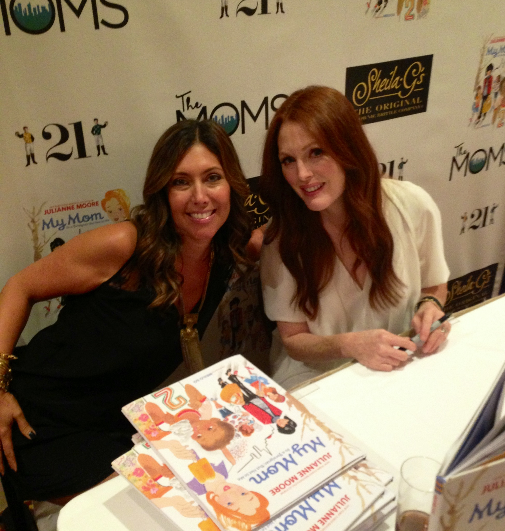 """With Julianne Moore after she signed a copy of """"My Mom is a Foreigner But Not to Me"""" to my niece Madison."""