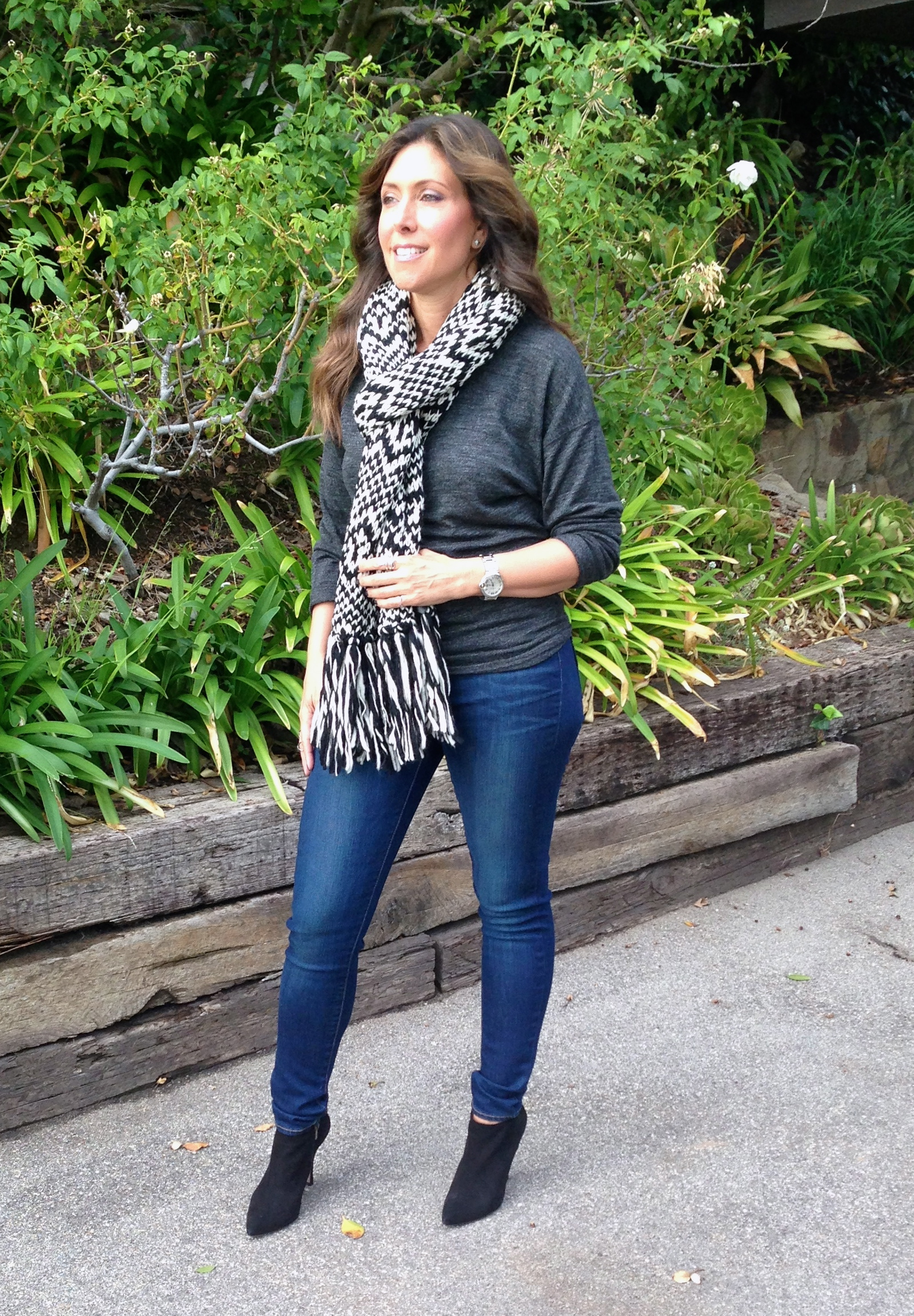 Isabel Marant knit scarf, $49.95. Pura Lopez low cut high heel boots in black, $410.