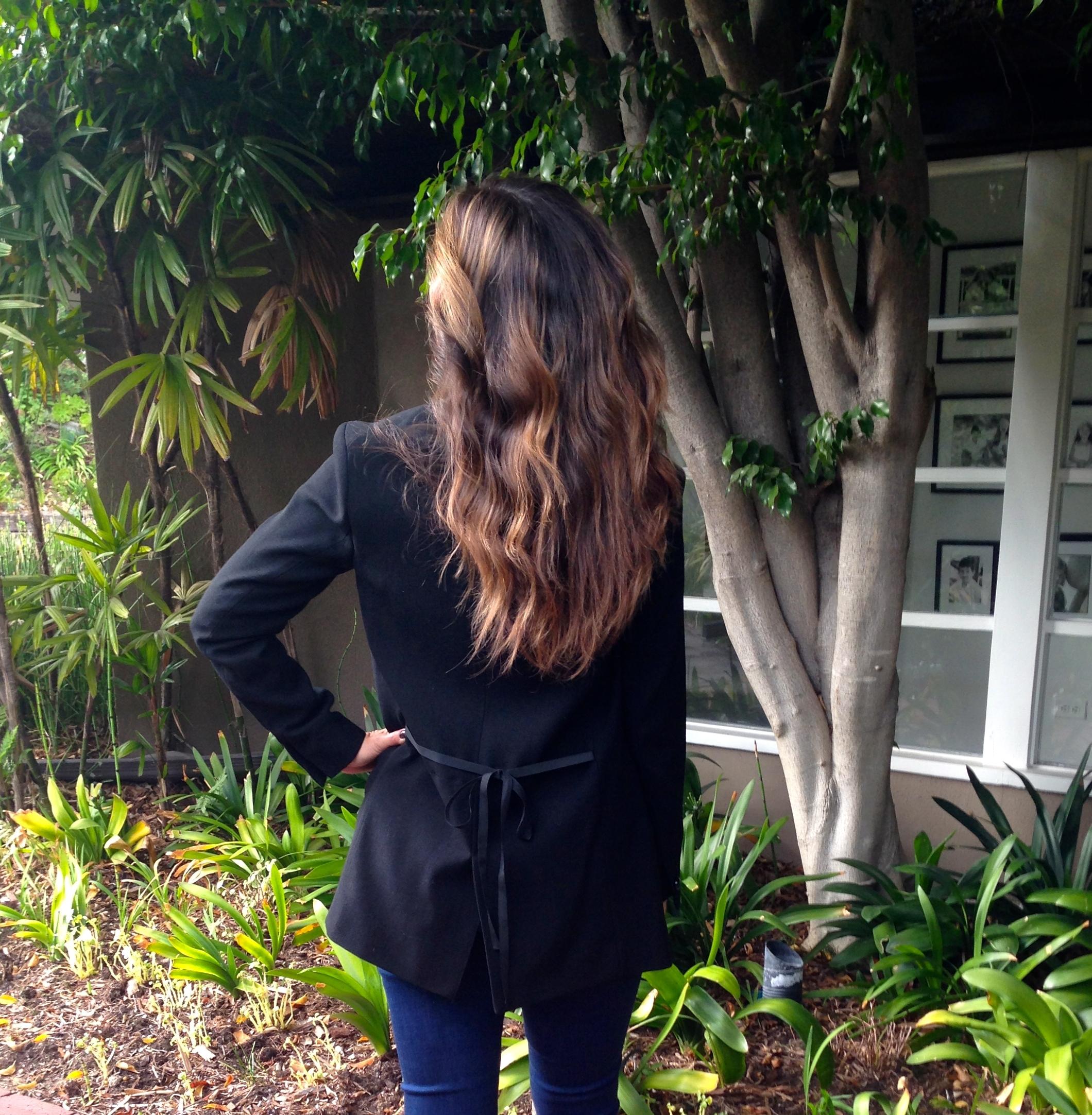 Details on the back of the black tuxedo blazer.
