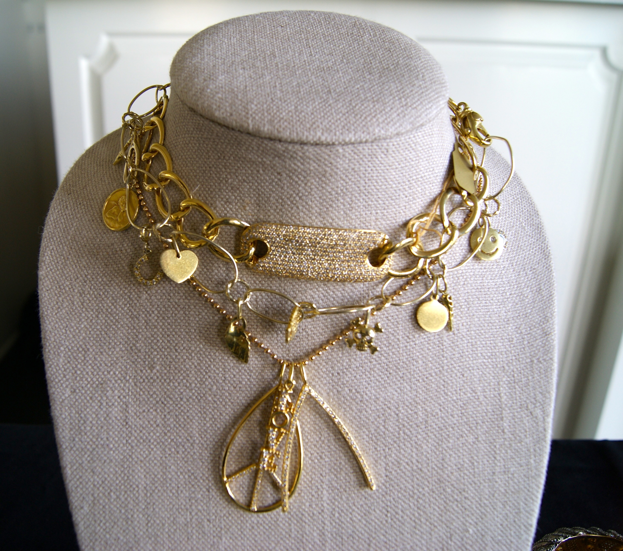 Kelly Gerber Jewelry. Details on a grouping of gold and diamond necklaces.