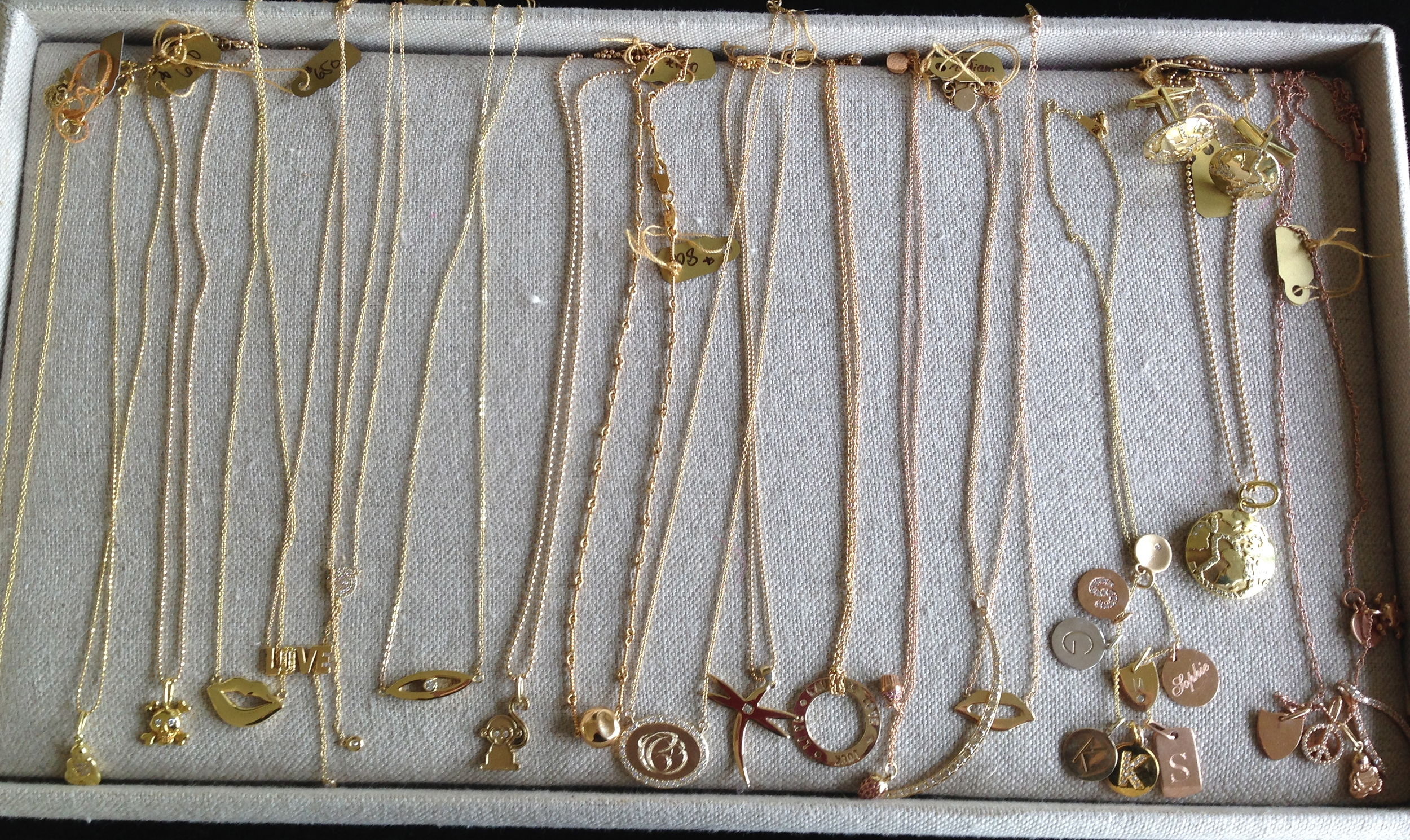 Kelly  carries a variety of  sweet necklaces and charms…these also make great gifts.