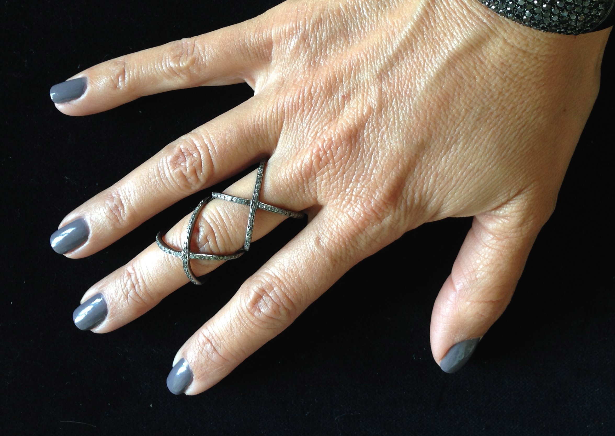 Double X ring with black diamonds, $350. Contact Kelly at  Kelly@KellyGerber.com  for sizes.