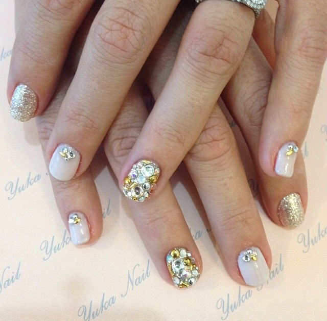 Gel mani using energizing crystal powder with rhinestones.