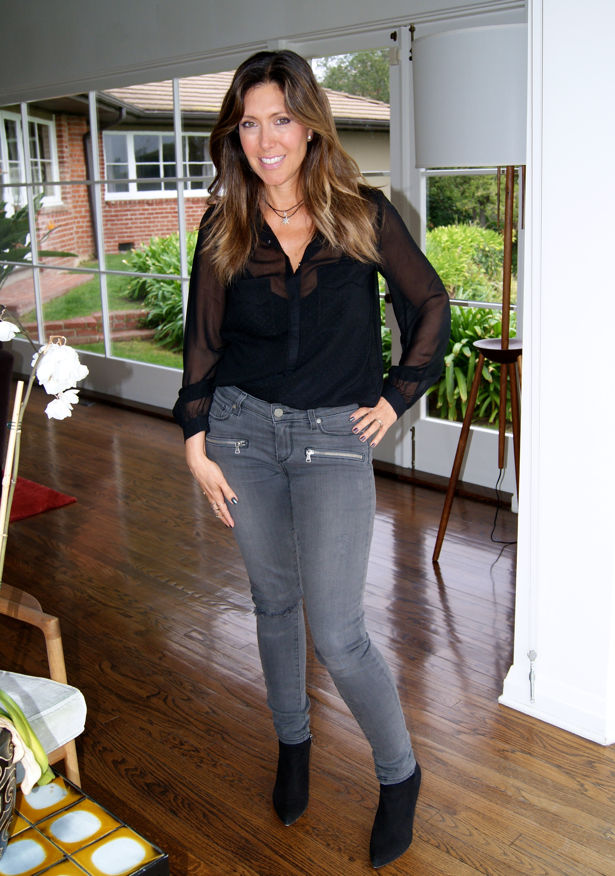 Paige gray wash jeans worn with a Zadig and Voltaire blouse and Pura Lopez black booties.