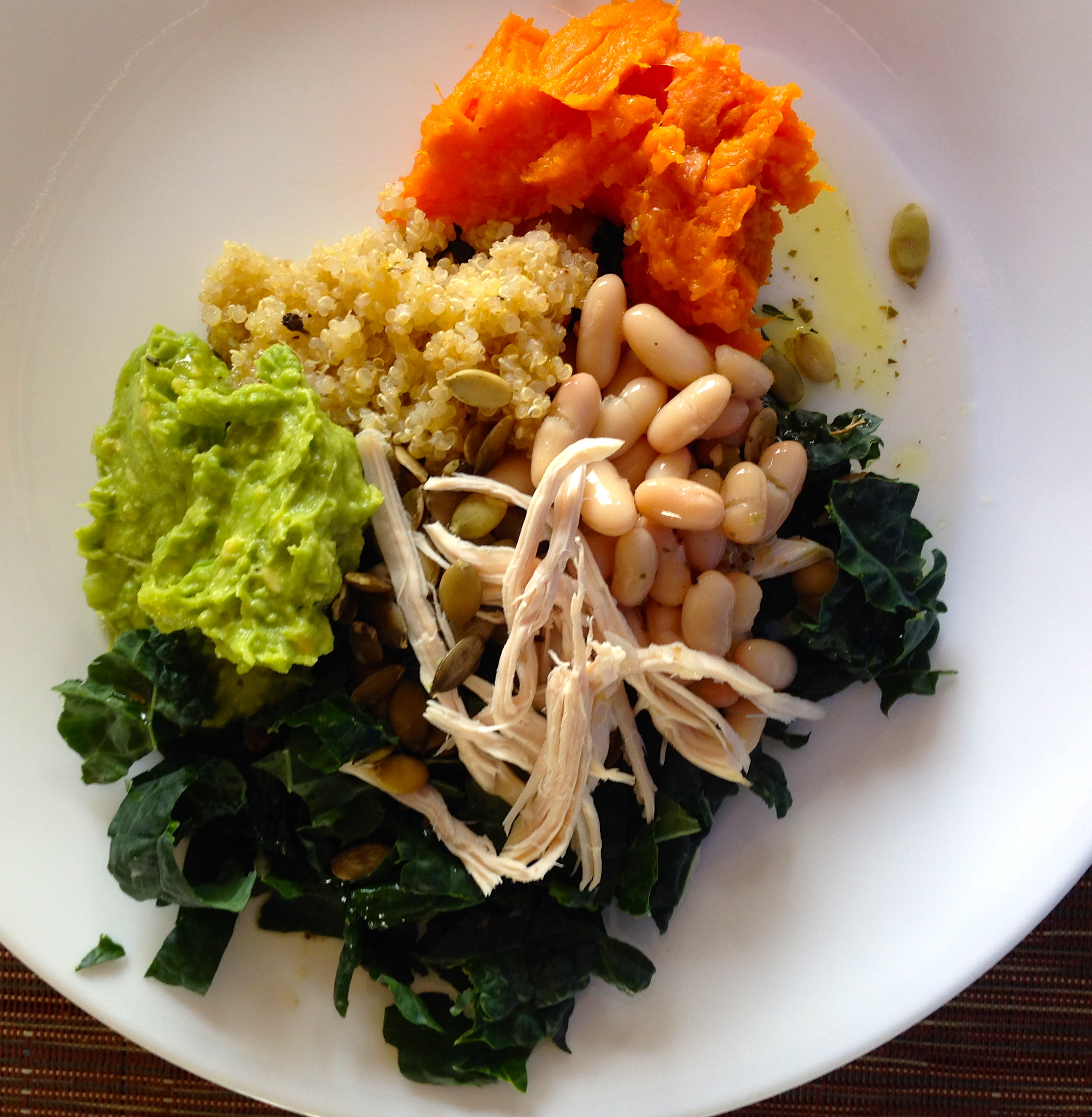 "One of my fave concocted ""cleanse salads"" that mixes sweet with savory. Shredded dinosaur kale, Tuscan beans, mashed avocado, quinoa, mashed sweet potato, pumpkin seeds.  Dressing: olive oil, lemon, salt and pepper. Splash of red wine vinegar."