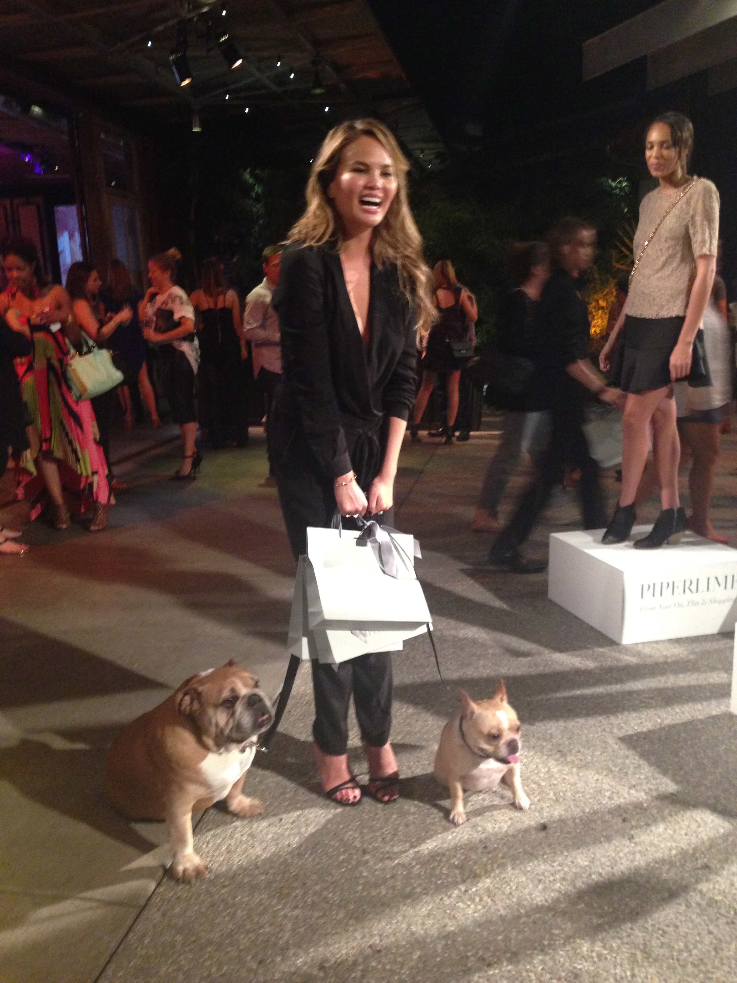 Chrissy Teigen (wearing Piperlime Collection) and her pooches at the event!