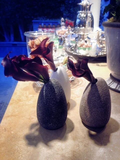 Vases shown from adinner party at the home of Shelley Zalis. Ostrich Egg Vase (Gray, White, Sand), $25 each