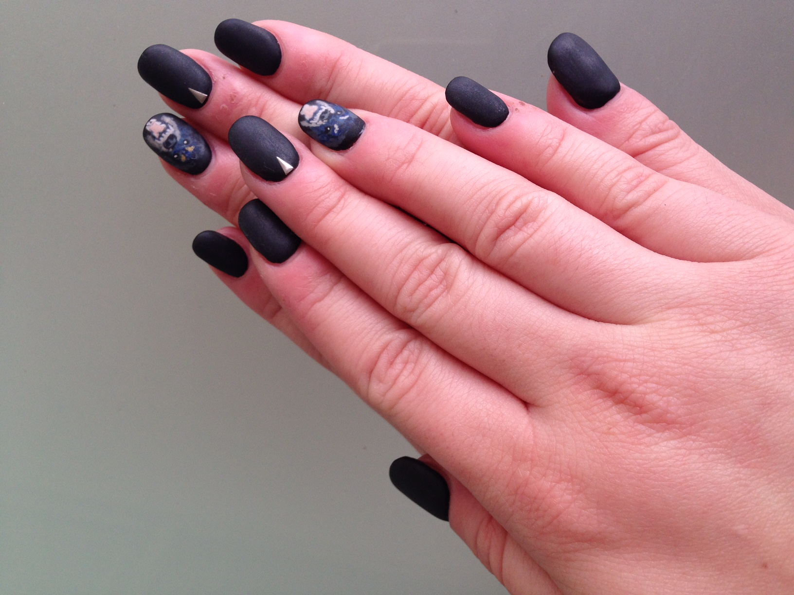 Matte gel manicure shown with Givenchy dogaccent nail.