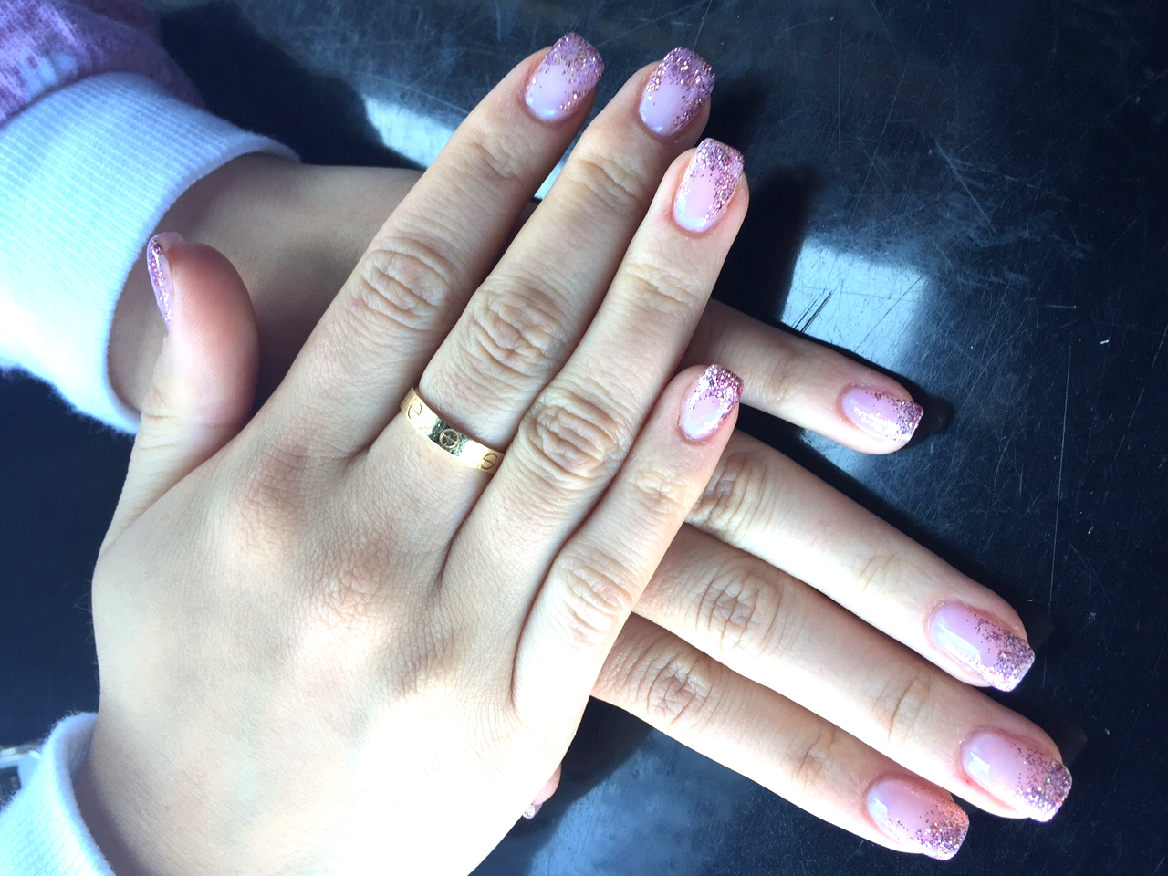 Pretty in Pink with glitter tips. Hand model Heather Braverman.