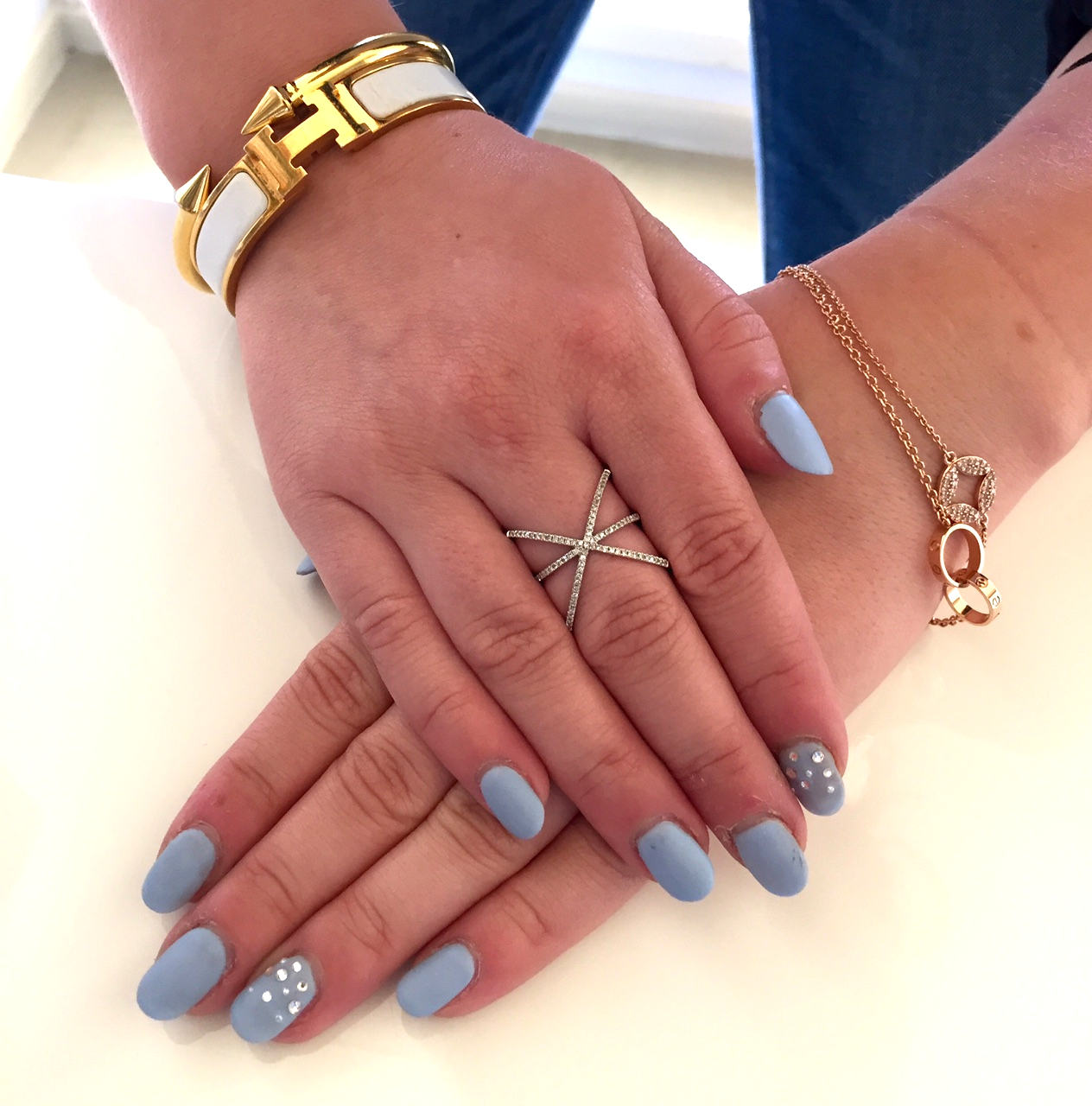 Matte baby blue with stone accent nails. Hand model Rachel Meyers.