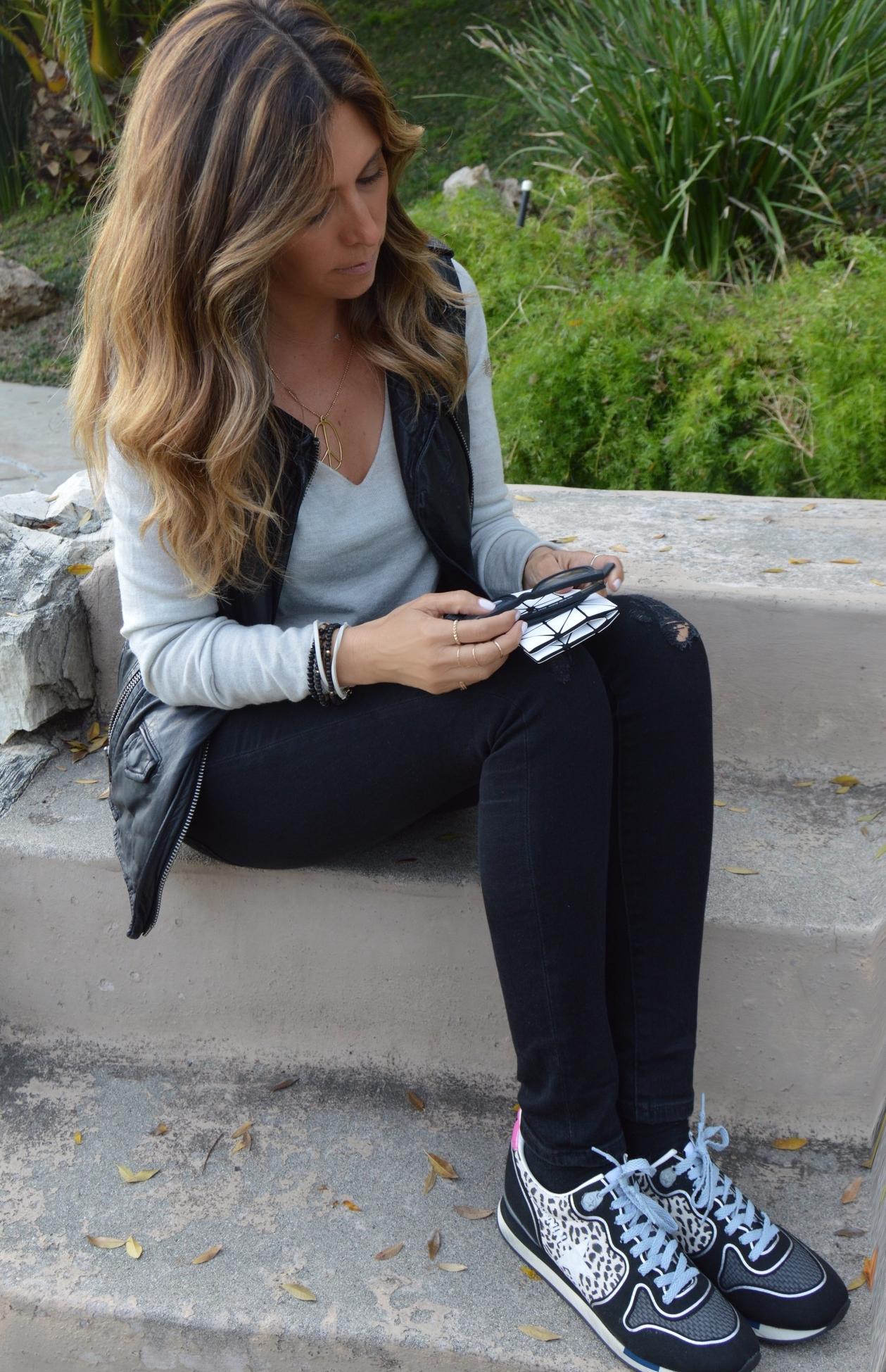 Golden Goose Running Sneakers (on sale!) , BLANKNYC leather vest , AG destressed black denim , Helmut Lang Sweater , Eyebobs Black glasses , Herschel Supply Co Beanie , Bao Bao Issey Miyake Card Holder