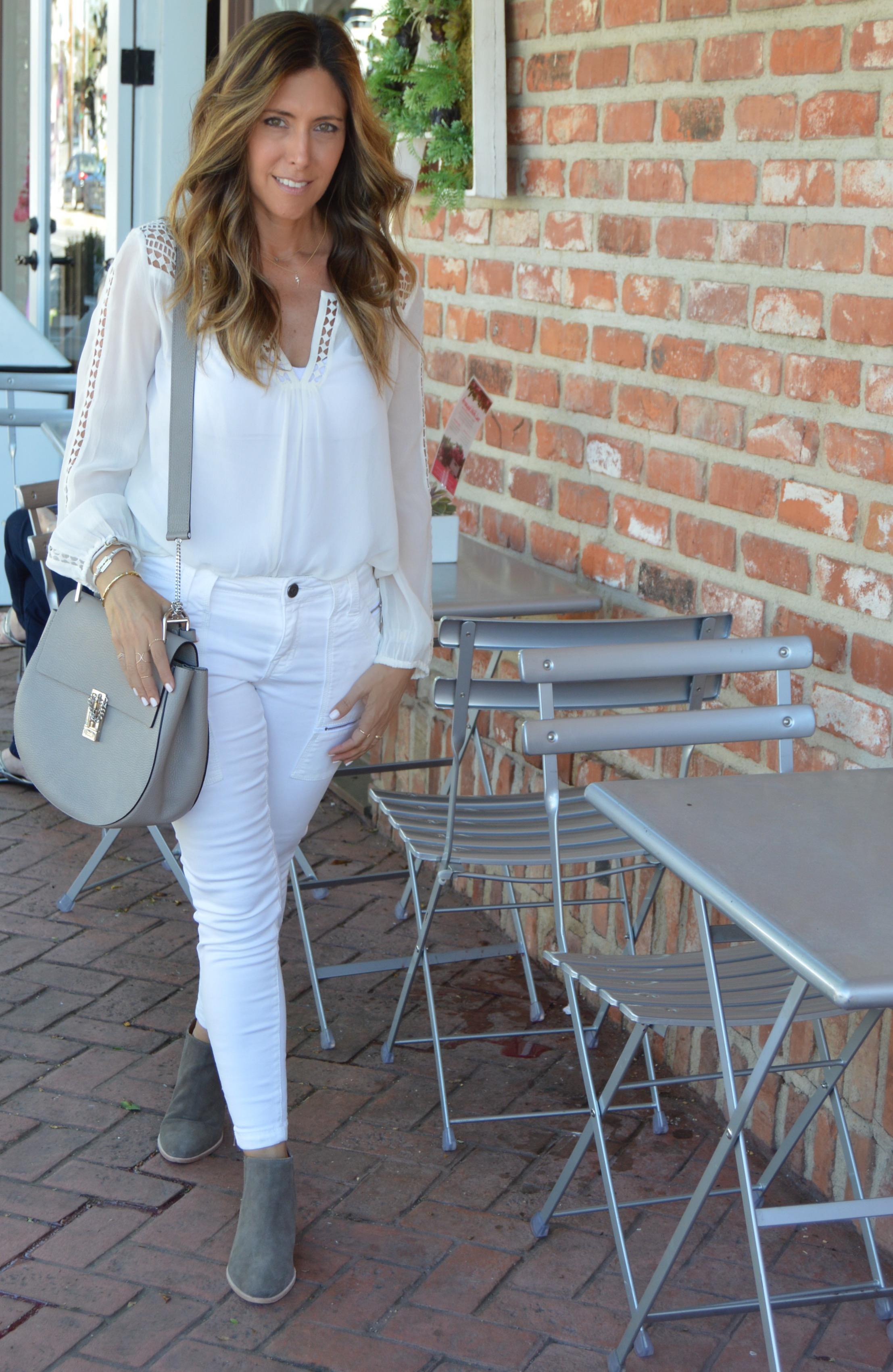 Melissa Meyers in Joie Leblanc blouse, skinny jean & boot with Cosabella Camisole & Chloe Drew Medium Bag