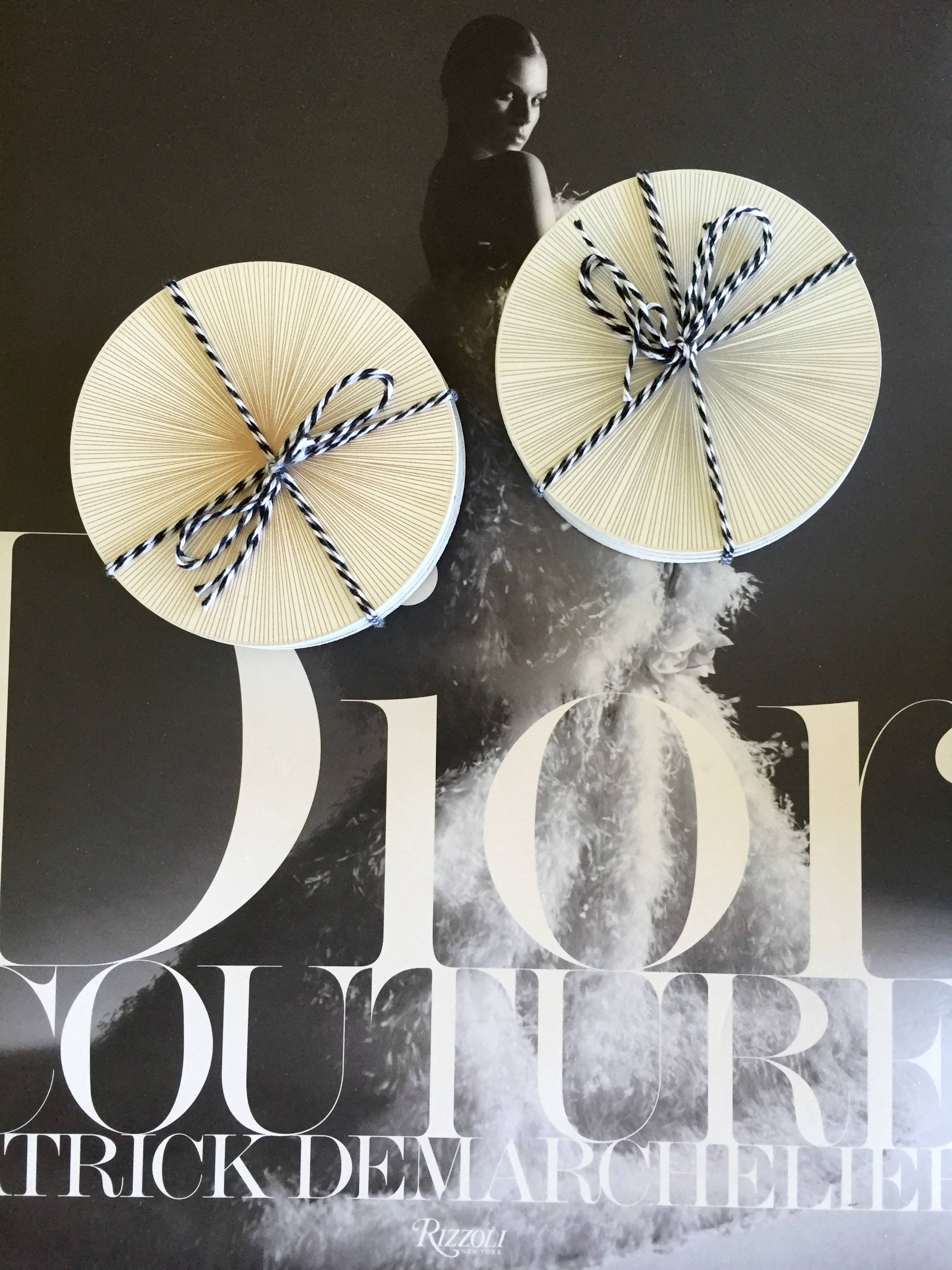 """Tisch graphic lines coasters  shown in gold and silver. I purchased these in advance and styled them here on top of my favorite coffee table book, """"Dior Couture"""" by famed photographer Patrick Demarchelier, $98. They are sold individually and come in different colors and patterns."""