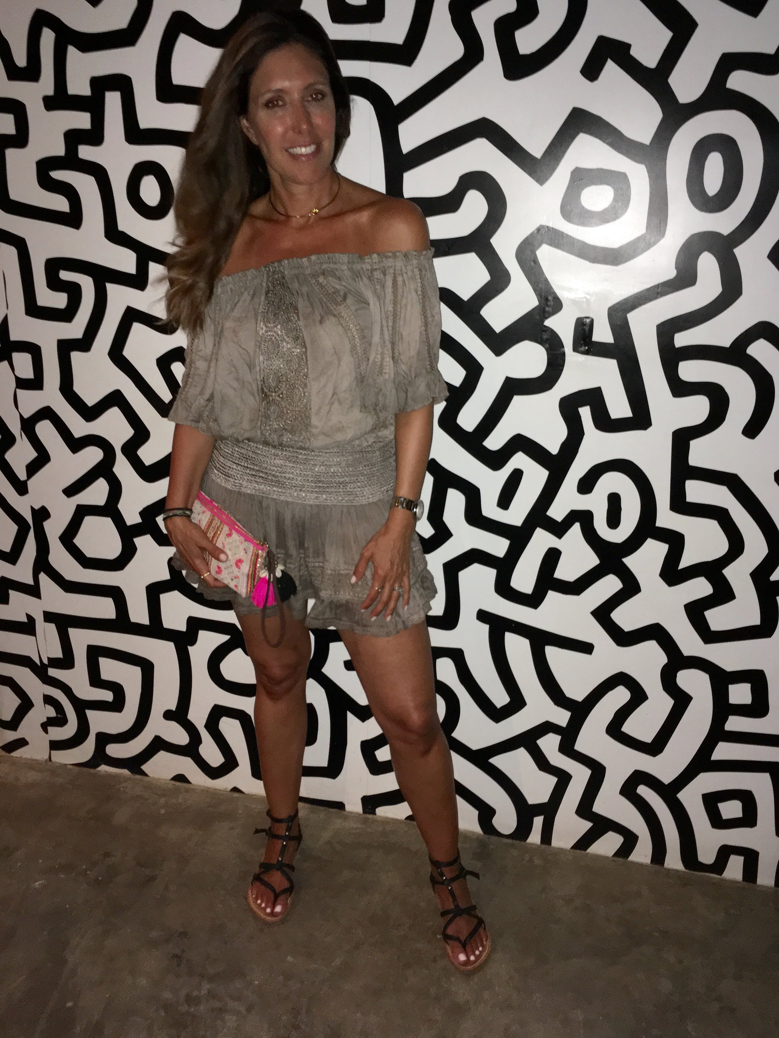 T op and skirt by  Sunday St Tropez . Sandals by  K. Jacques , Clutch bag by  JTribe