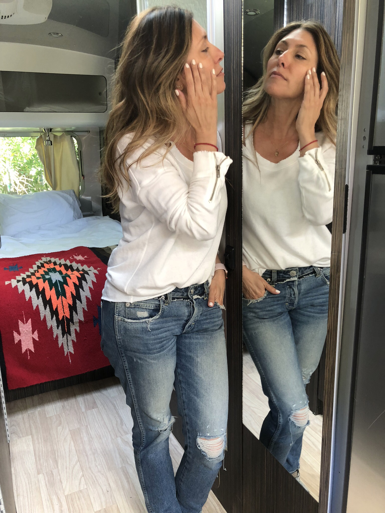 Smoothing on some  RoseGlow drops  for dry skin! Now sold on  AMAZON !!! Cut out  Sweatshirt by N Philanthropy  Fave  boyfriend jeans by AMO