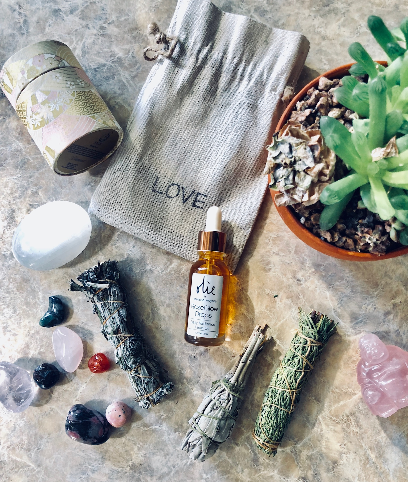 The  Sage Lifestyle Onyx Candle  (my fave scent),  Flight of the Heart Love Pouch Crystals,  Olie X Melissa Meyers  RoseGlow drops.
