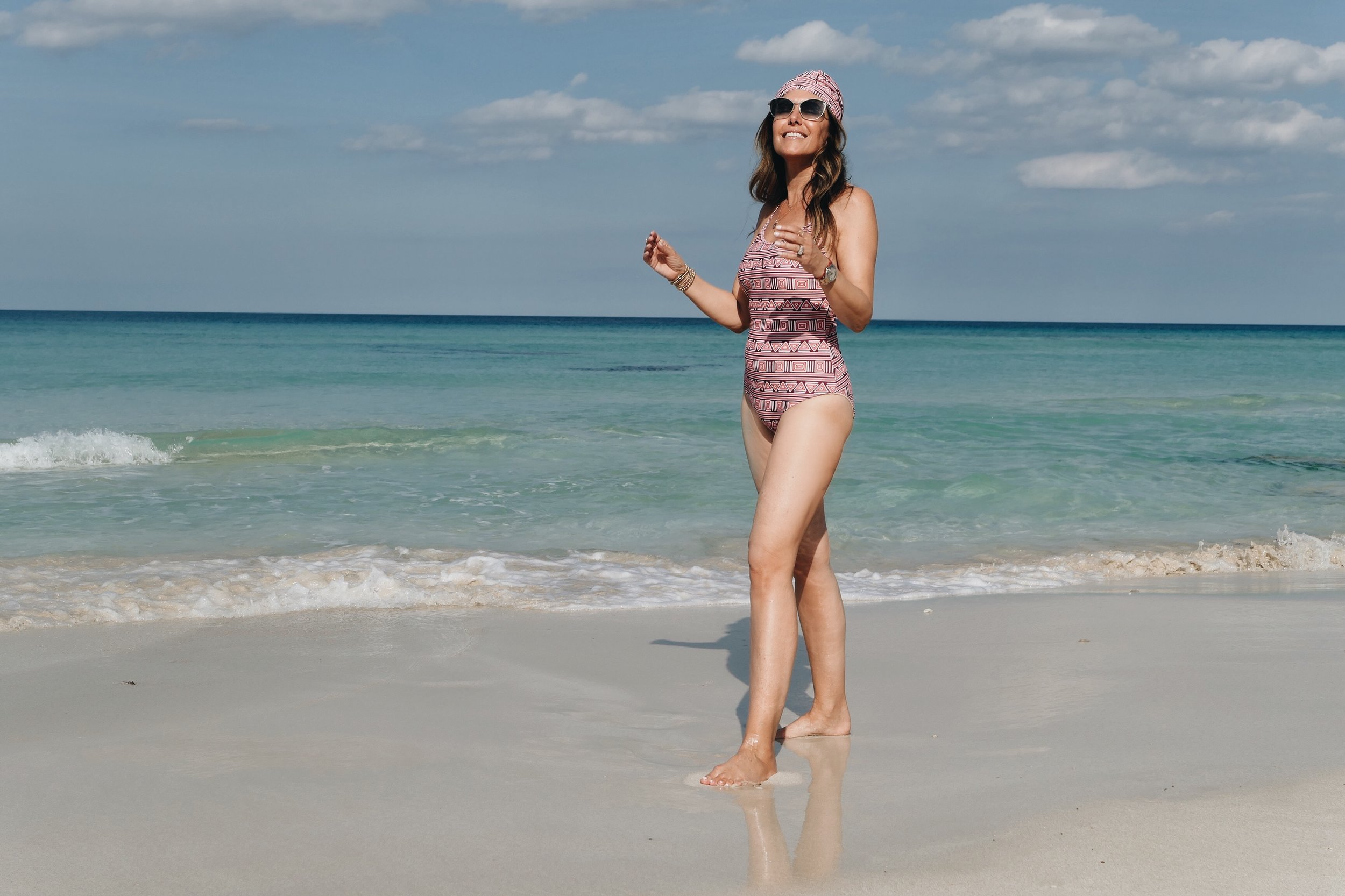 Beach day at Miya Cayito. Melissa wearing  Mott50 X Margherita  one piece swim suit.