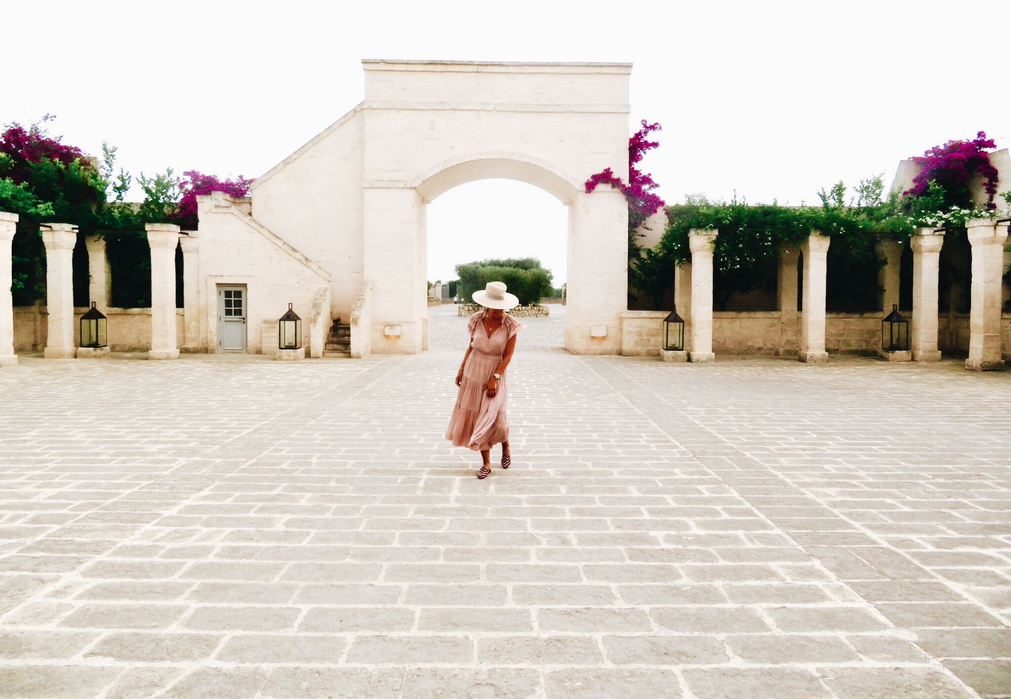 Entrance at the  Borgo Egnazia , Puglia. Dress by Ulla Johnson.  Similar here