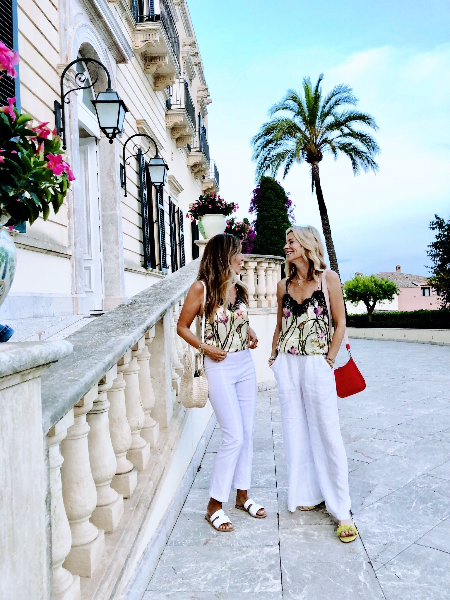 With Janet Gunn  Grateful Gardenia  in Sicily at The  Belmond Grande Hotel Timeo . Wearing  Franne Golde magic pants  in white.   Use code MM10 for 10% off while shopping    www.frannegolde.com   .   Silk top by Hark + Hammer,  Bag by ClareV,   Sandals  by  Ancient Greek Sandals .