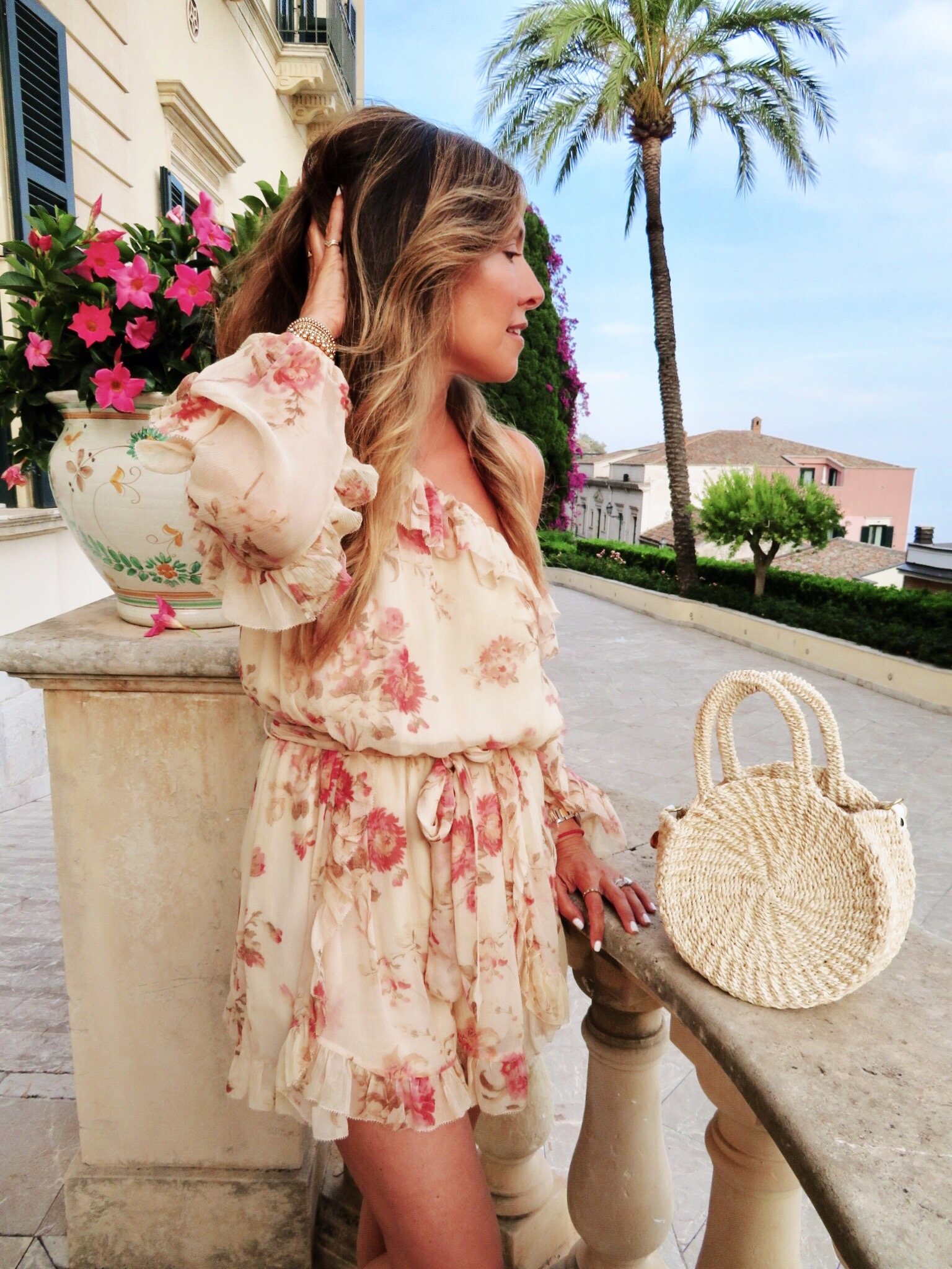 Belmond Grand Hotel Timeo . Wearing a Zimmerman ruffled floral playsuit.  Similar here .