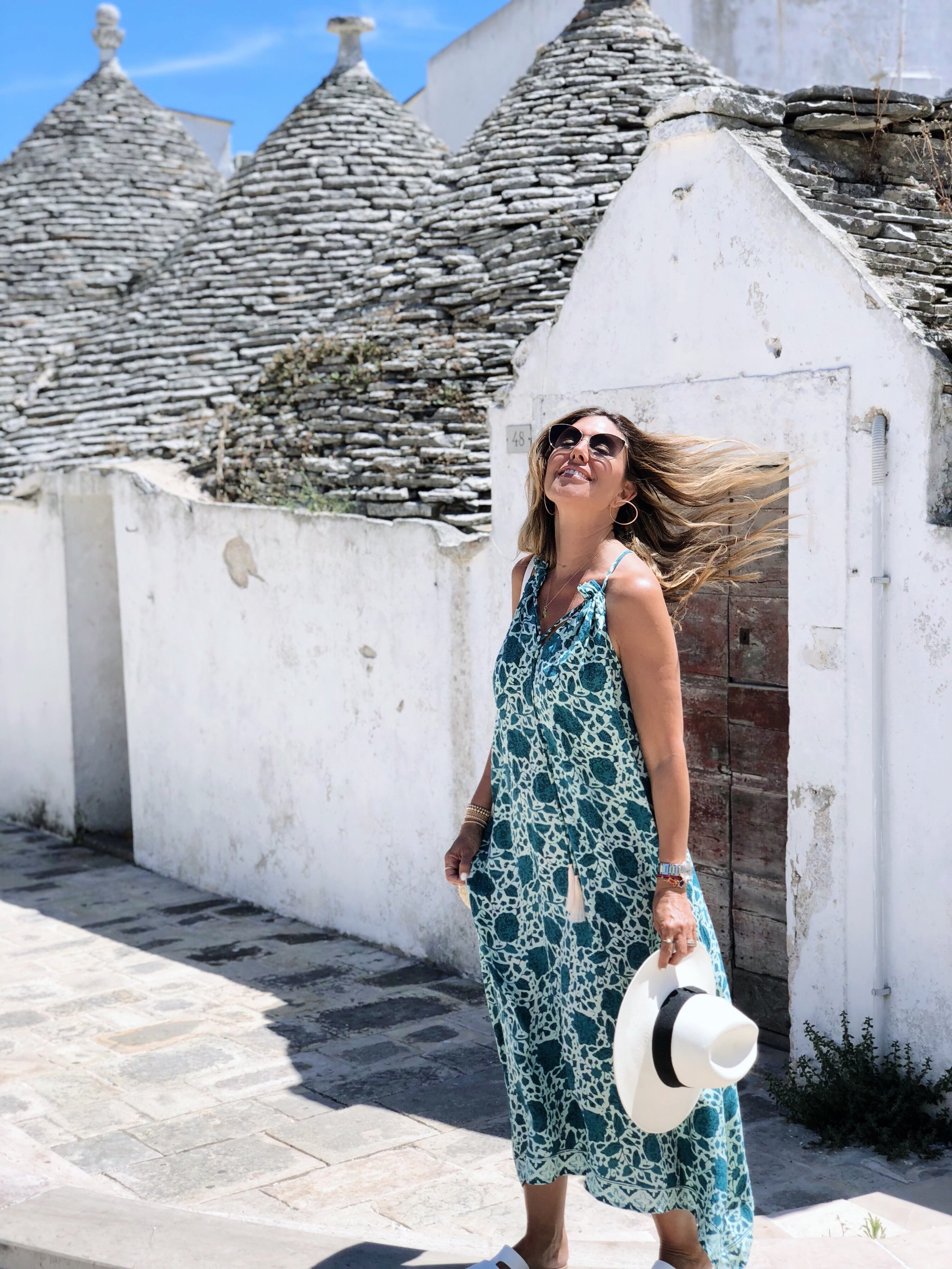 Visit to  Alberobello  .  Dress by  Natalie Martin . Sunnies by  Oliver Peoples . Sandals by  Ancient Greek sandals .  Similar dress here.