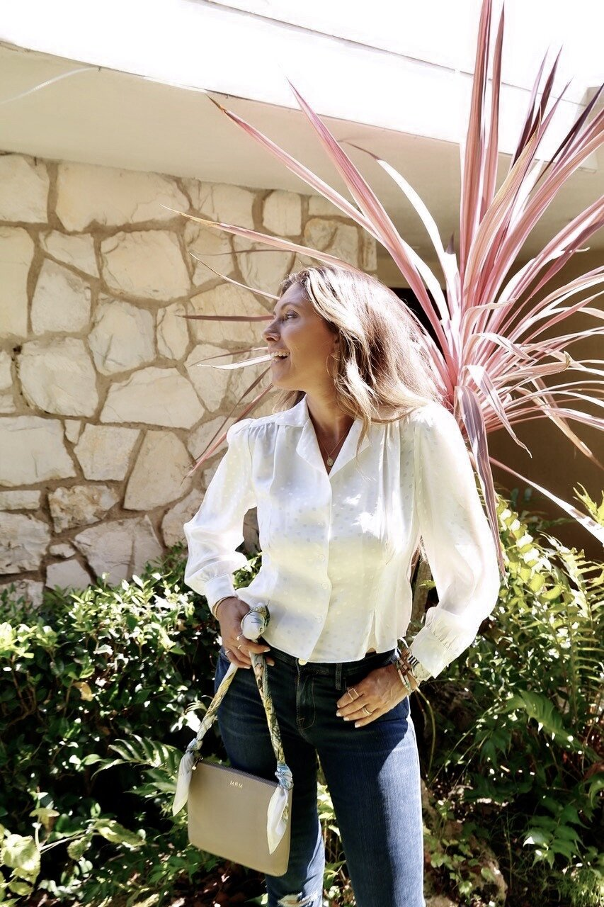 Here I'm wearing the   Lenora White Silk Blouse with Puff Sleeve  . It pairs seamlessly with any denim!