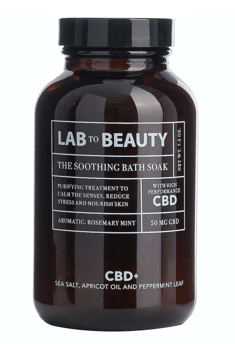Lab To Beauty Soothing Bath Soak  - Formulated with high-performance CBD, Dead Sea Salt, and Apricot Oil, it works to rebalance and remineralize skin, while fighting inflammation.