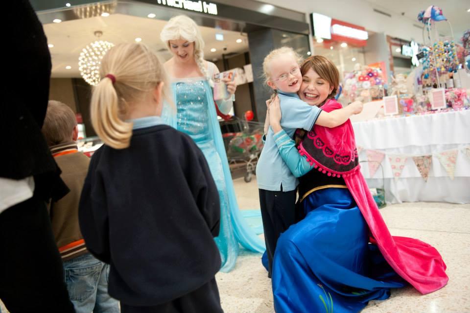 Elsa and Anna Hugs.jpg